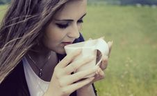 Free Girl Drinks Coffee With Pleasure Outdoors Royalty Free Stock Images - 31892879