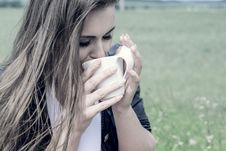 Free Girl Drinks Coffee With Pleasure Outdoors Stock Photo - 31893000