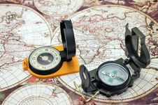 Two Compass Lie On The Map Stock Image