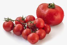 Bunch Of Fresh Juicy Ripe Cherry Tomatoes Set On White Background And Isolated With Precise Clipping Path