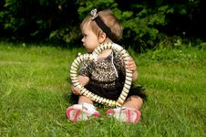 Free Little Child Is Sitting On The Grass Royalty Free Stock Photos - 31961428