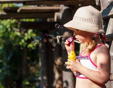 Free Little Girl Blowing Soap Bubbles Royalty Free Stock Photography - 31962237