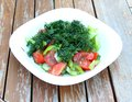 Free Vegetable Salad In White Plate On Garden Table. Stock Photo - 31979310