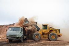 Free Loading Truck With An Excavator Stock Images - 31988434