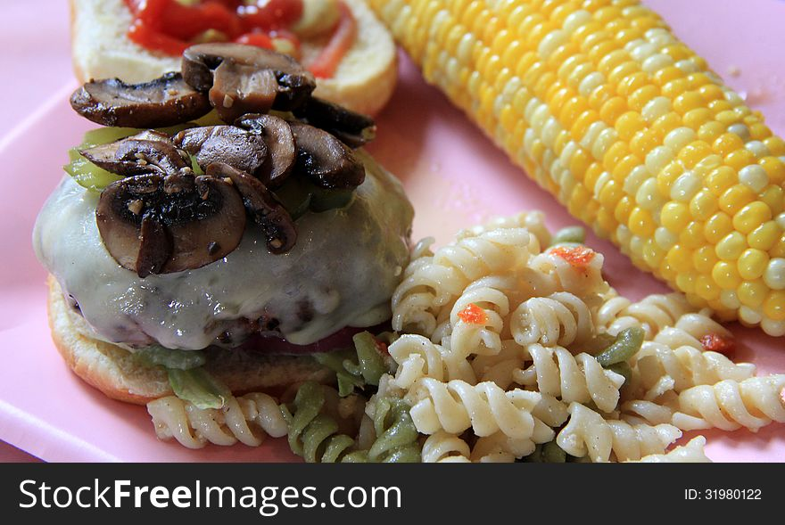 Perfect burger and corn on the cob
