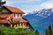 Free Swiss House And Mountains Royalty Free Stock Photo - 31980635