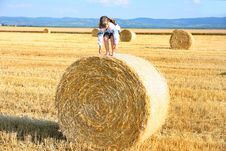 Free Girl On The Straw After Harvest Field With Straw Bal Stock Photo - 31991370