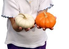 Free Girl Holding Pumpkins Stock Image - 323971