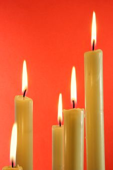 Candles Over Red Background Royalty Free Stock Images