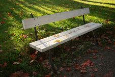 Autumn Bench And Colorful Leaves Royalty Free Stock Photography