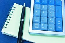 Free Calculator And Pen On Blank Notebook Stock Images - 32000934