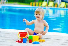 Toddler Playing By The Pool Stock Photo