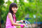 Free Little Asian Girl In A Bicycle Royalty Free Stock Photo - 32005495