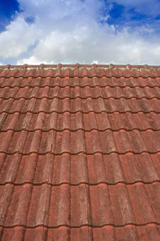 Free Tiled Roof With Fluffy Cloud Blue Sky Stock Photo - 32020760