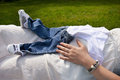 Free Belly Of A Pregnant Woman Holding Baby Clothes Close-up Royalty Free Stock Images - 32042839