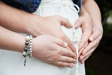 Free Arms Of Mother And Father. Pregnancy Stock Images - 32042544
