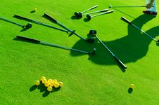 Free Iron Golf Club And Golf Ball On Green Grass Royalty Free Stock Photo - 32047725