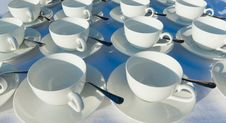 Free Stacked Empty Teacups With Teaspoons At A Function Over White Ba Royalty Free Stock Image - 32047786