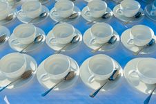Free Stacked Empty Teacups With Teaspoons At A Function Over White Ba Royalty Free Stock Photo - 32047815