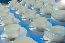 Free Stacked Empty Teacups With Teaspoons At A Function Over White Ba Stock Photos - 32047843