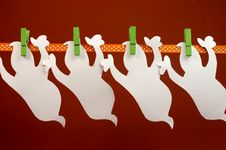 Free Celebrate Halloween With White Ghost Party Bunting Hanging From Green Pegs On A Line Stock Image - 32058331