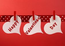 Free Happy Valentines Day Message Greeting Written Across White Heart Tags Hanging From Red Pegs On A Line Stock Photo - 32075910