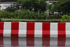 Free Wet Concrete Barrier. Royalty Free Stock Photos - 32080068