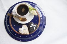 Free Two Wedding Cookies With A Cup Of Coffee On The Plate Stock Images - 32090204