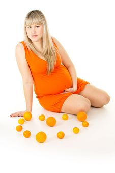 Free Pregnant Woman Sitting With Oranges Stock Images - 32099554