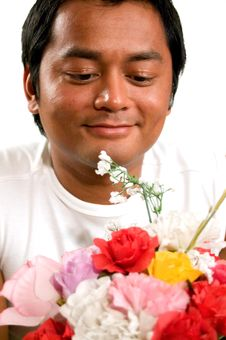 Free Man Holds Bunch Of Flowers Stock Photo - 3213530