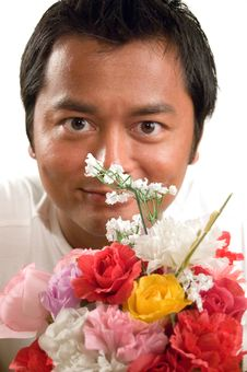 Free Handsome Man Holds Flowers Royalty Free Stock Photo - 3213535