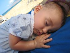 Baby Sleeping On The Beach Stock Photography