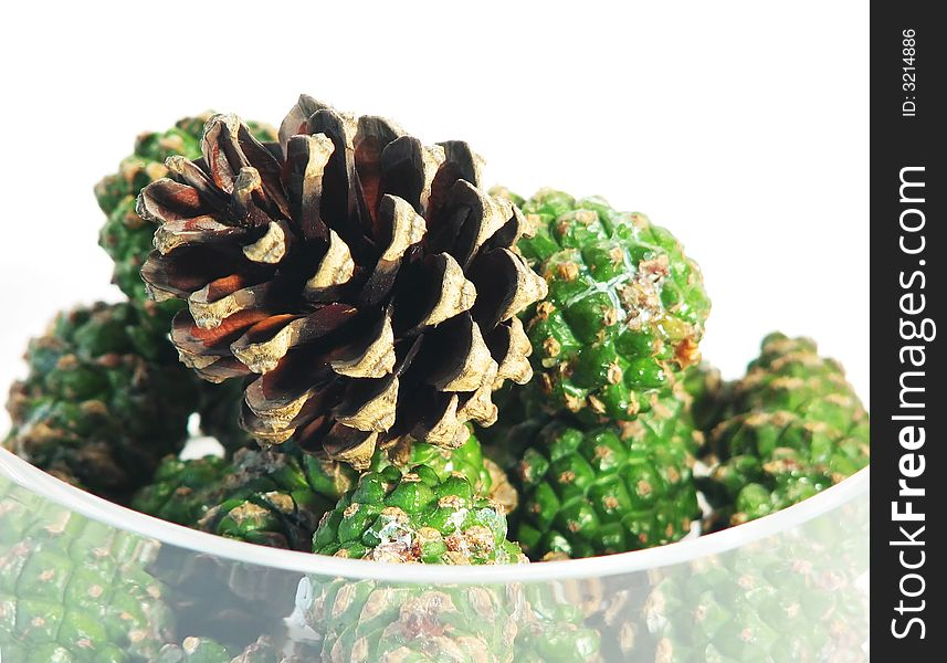 Pine cones in glass bowl