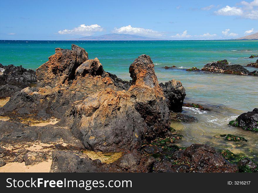 Rocky Shoreline By The Sea