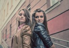Free Two Beautiful Sisters Of The Girlfriend Stand On Street Royalty Free Stock Image - 32107316