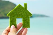 Hand Holding Green House Icon Stock Photo