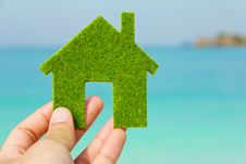Hand Holding Green House Icon Stock Image