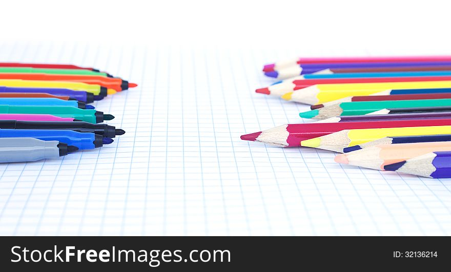 Felt pens and pencils  opposite each other