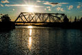 Free The Railway Bridge Through The River At Sunset Stock Images - 32173024