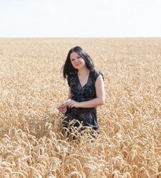 Girl On The Field With Wheat Stock Photo
