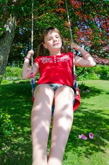 Fun On Garden Swing Stock Images