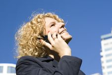 Business Woman Talks By Phone Stock Photo