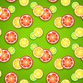 Free Slices Of Fresh Citrus Fruits On Green Polka Dot Stock Photo - 32200940