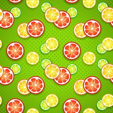Slices Of Fresh Citrus Fruits On Green Polka Dot Stock Photo