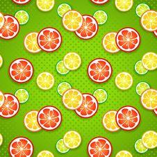 Slices Of Fresh Citrus Fruits On Green Polka Dot Stock Photo