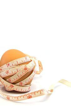 Egg With  Tape Measure On White Background. Royalty Free Stock Photos