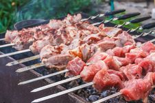 Shish Kebab In Process Of Cooking On Open Fire Outdoors Royalty Free Stock Photo