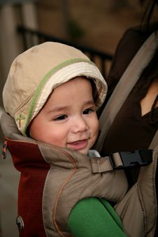 Baby Riding In A Front Carrier Stock Photo
