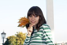 Free Girl Holds Autumn Leafs Stock Images - 3231444