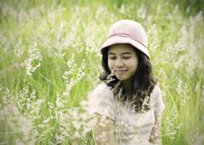 Young Woman On The Meadow With White Flowers On A Warm Summer Da Royalty Free Stock Image